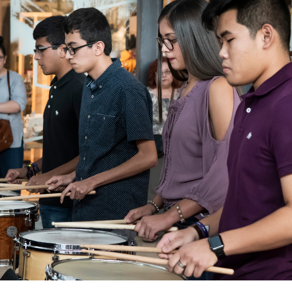 Photo of youth playing drums.