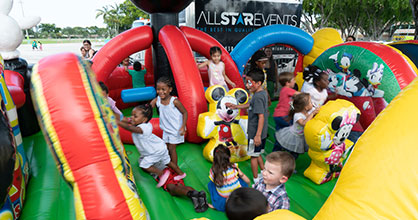 Kids enjoy themselves in a bounce house at The Children's Trust Family Expo.