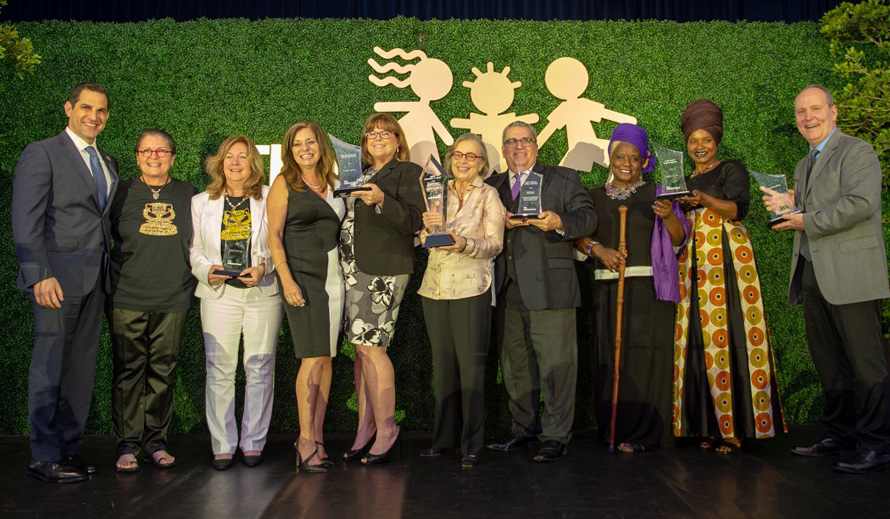 Honorees at the 2018 Champions for Children Awards on stage with Children's Trust President/CEO James Haj