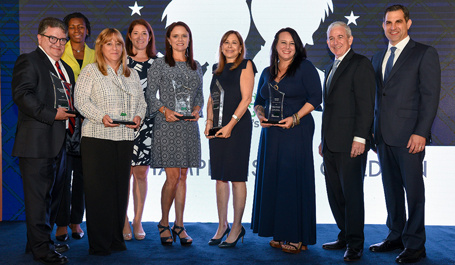 Photo of Centro Mater Miami, FL Executive Director J. Abilio Rodriguez; Nicklaus Children's Hospital School Health Program Program Coordinator Cleo Chumiso and Program Director Cindy Harrah, ARPN; Easterseals South Florida Education Services Director Camila Rocha and CEO Loreen Chant; 2019 David Lawrence Jr. Champion for Children Award recipient Judge Jeri Beth Cohen; and Michelle Forman of Guitars Over Guns; The Children's Trust Board Chair Kenneth Hoffman and President/CEO James R. Haj