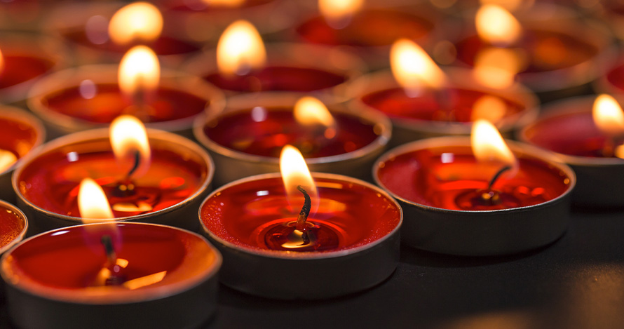 Red candles representing various faiths during holidays.