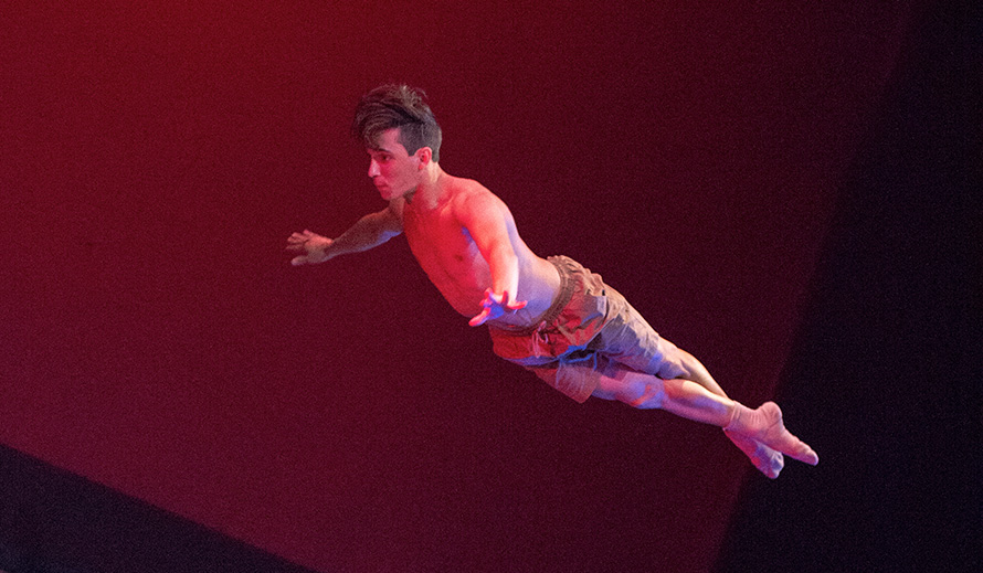 Dancer photographed in mid-air leap.