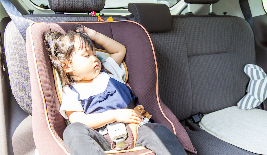 Sun shines on little girl in car seat.