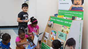 Kids browsing books at a Read to Learn Books for Free book shelf.