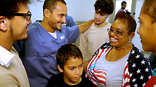 Children and program coordinator visit incarcerated father