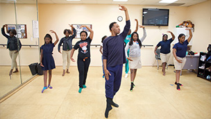 African American male youth leading ballet class