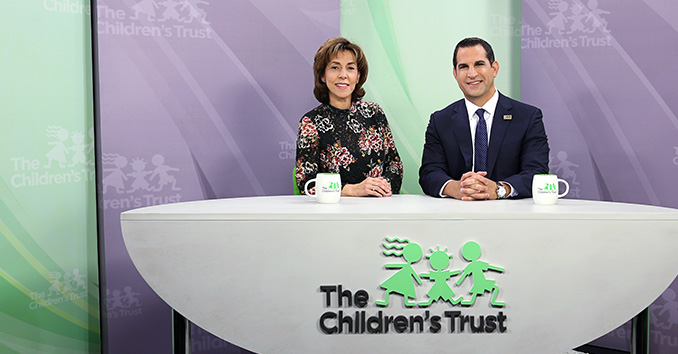 Photo of hosts Ileana Varela and James Haj on the set of Our Children TV Show