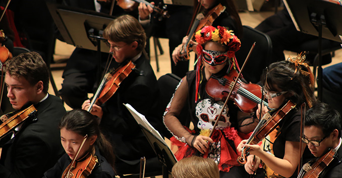 Orchestra performers dressed in disguises