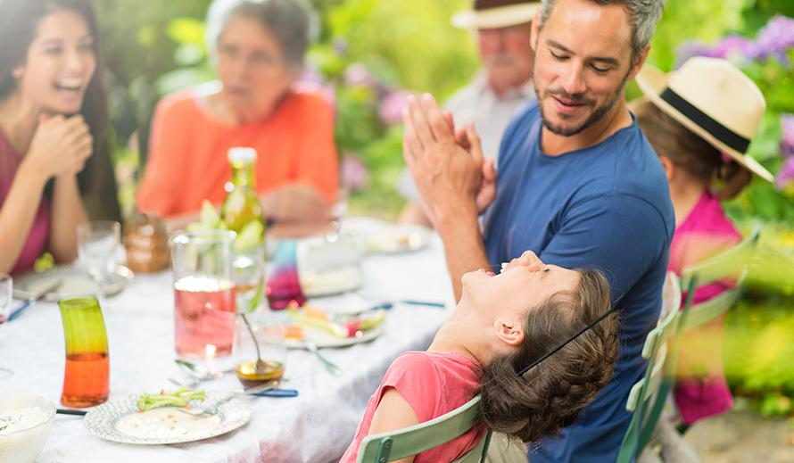 Happy mutigenerational family enjoying a meal.