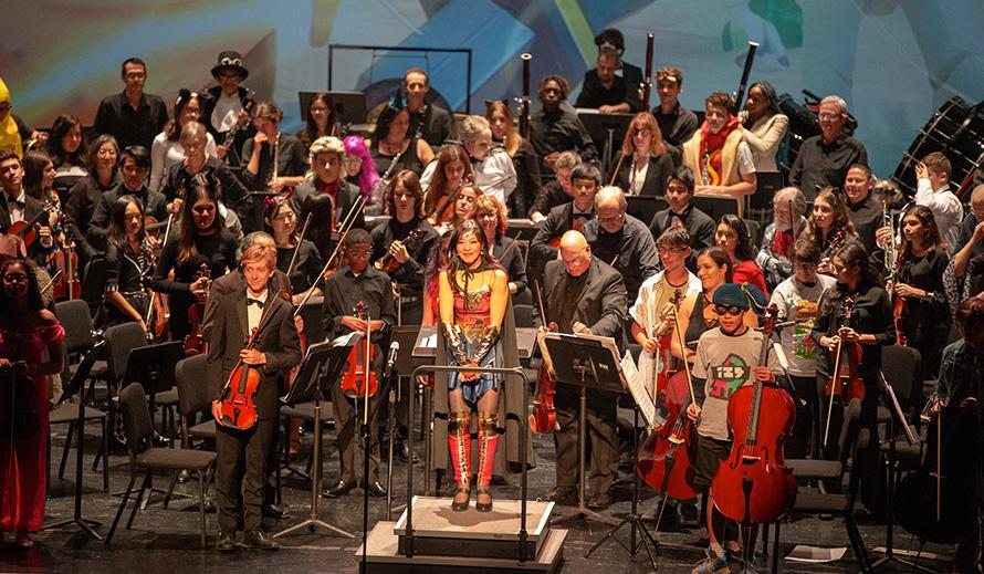 Wonderwoman, aka Maestra Huifang Chen, conducts the Greater Miami Youth Symphony.