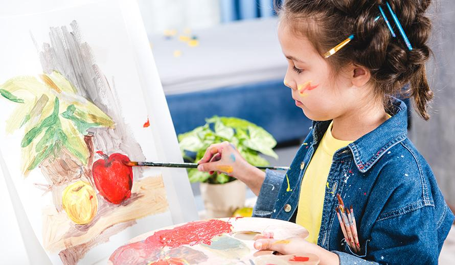 Girl painting an apple
