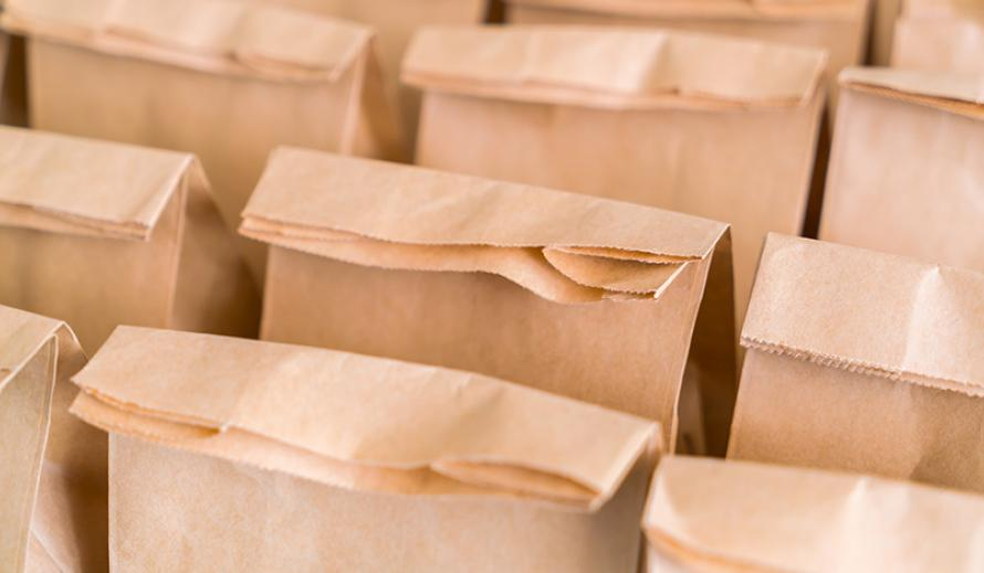 Rows of bagged lunches for students.
