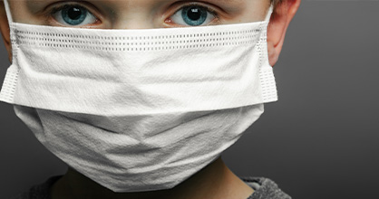 Concerned boy uses a mask during Coronavirus pandemic.