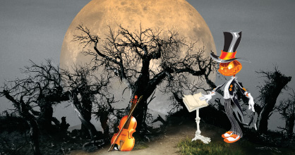 Image of pumpkin conductor in dreary forest at night with the full moon rising in the background