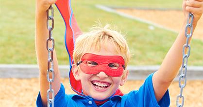 Boy on a swing smiling
