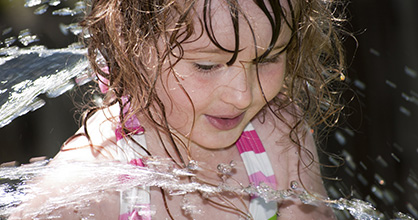 Happy little girl at a water park.