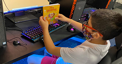 A child competes in the 2020 Battle of the Books online.