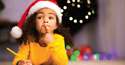 A young girl thinks about what to write during the holidays.