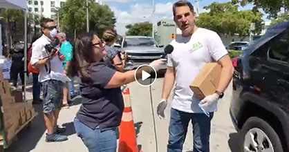 The Children's Trust President and CEO James Haj interviewed while volunteering at a diaper giveaway.