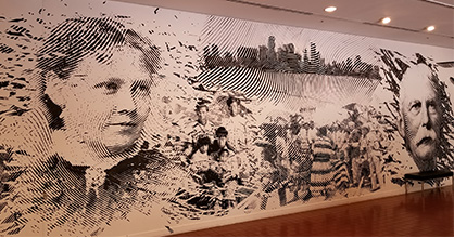 Mural at HistoryMiami Museum depicting historical figures including Julia Tuttle and Henry Flagler