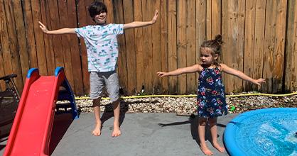 Kids demonstrate social distancing during a play date.