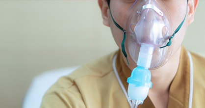 Boy with oxygen mask.