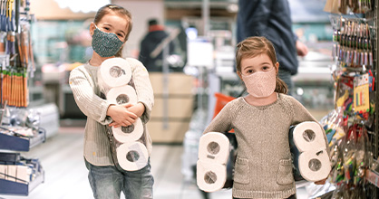 Two sister gather toilet paper from store during pandemic.