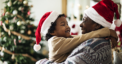 A boy hugs his grandfather during the holidays.