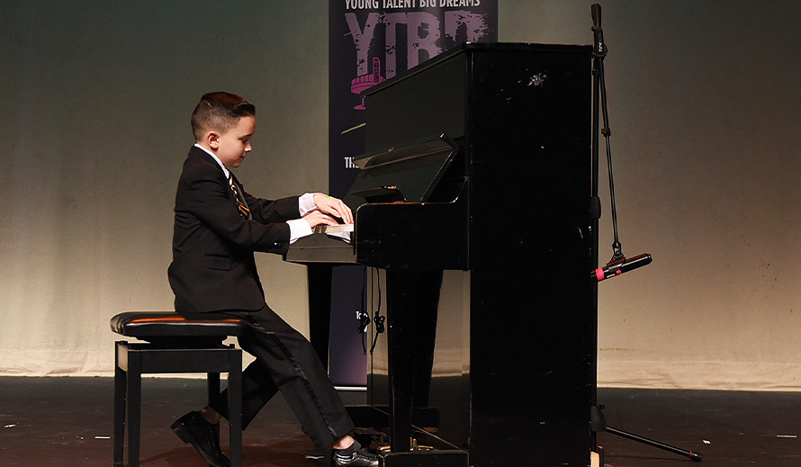 Anthony Rodriguez plays at auditions for Young Talent Big Dreams.